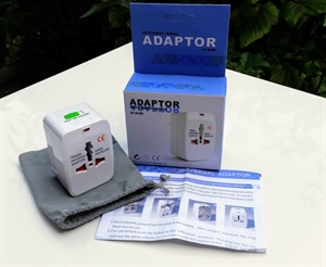 Universal AC travel adaptor, works in 150 Countries, folding pins, pouch